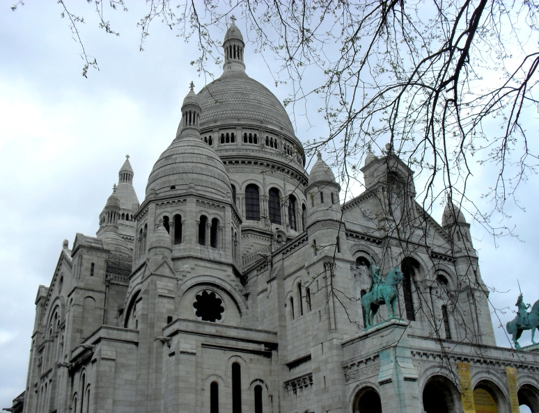 Sacre Coeur with the clouds looming in the distance